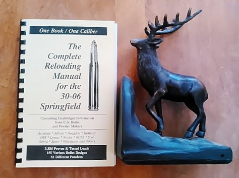 The Complete Reloading Manual for the .30-06 Springfield Rifle, Pictured Next To A Vintage Bookend of A Bull Elk. From The Collection of Michael Patrick McCarty