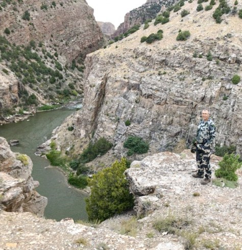 A Hunter Stares Down A Wild River Canyon On The Yampa River of Northwestern Colorado.