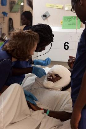 Photo Credit Deb Louden, Caryle Apendi EPOPO (COG) Local Congolese Nurse, works with Amy JONES (GBR) Ward Nurse, learning nursing skills in D ward.