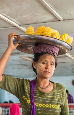 Selling pineapple on a ferry