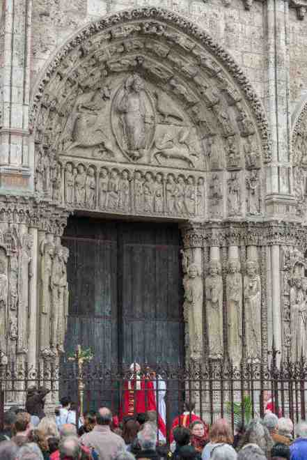 The bishop at the cathedral doors