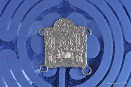 Modern replica of a medieval pilgrim badge worn by those who had been to Chartres Cathedral