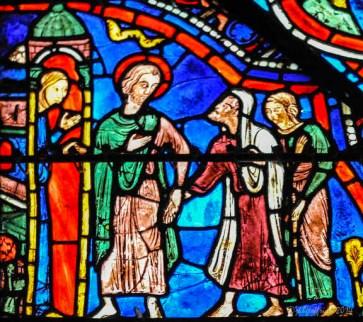 St. Juilen and his wife welcoming pilgrims
