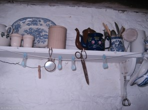 Shelf, The string with clothes pegs on it is my own.