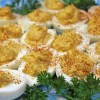 Plate of deviled eggs garnished with parsley