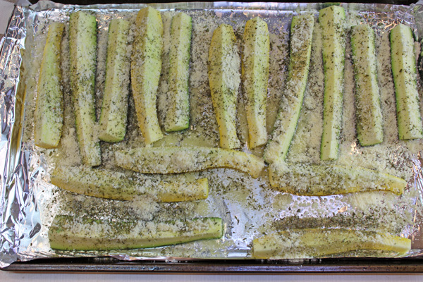 Parmesan cheese sprinkled over the oiled and seasoned squash and zucchini spears.