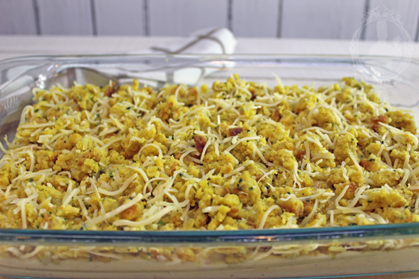 Stuffing/Cheese mix layered on top of the soup/chicken mix in the baking dish.
