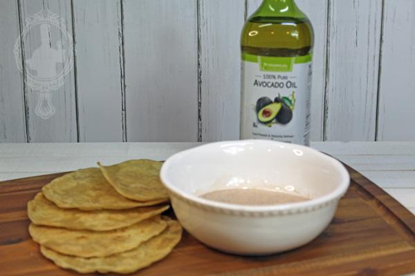 Ingredients for Sopapillas. Flour tortillas, cinnamon sugar mixture, and oil.