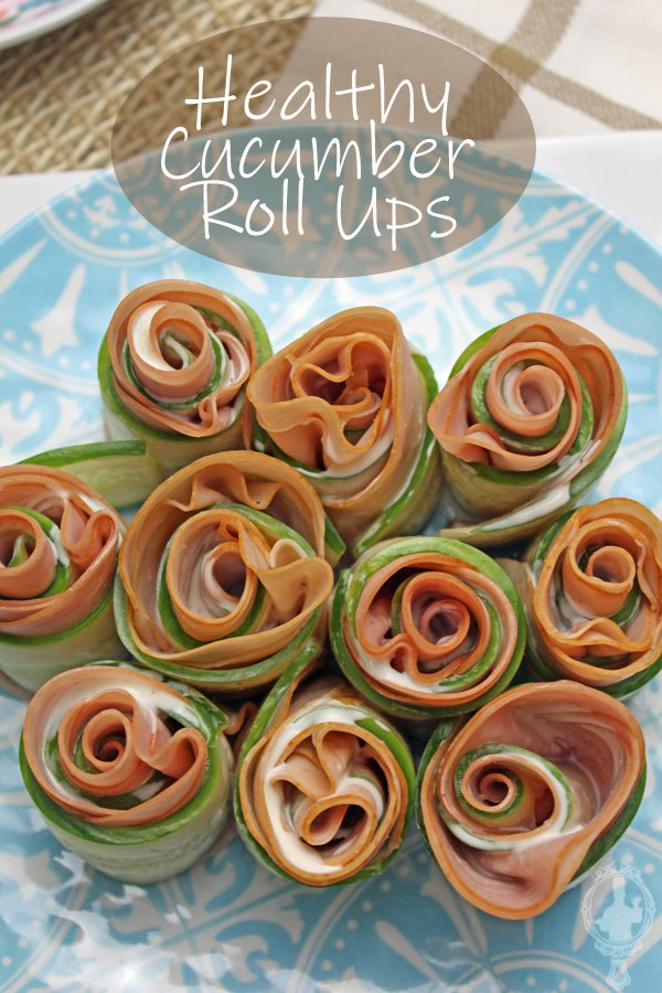 Overhead view of the cucumber roll ups on a blue plate.