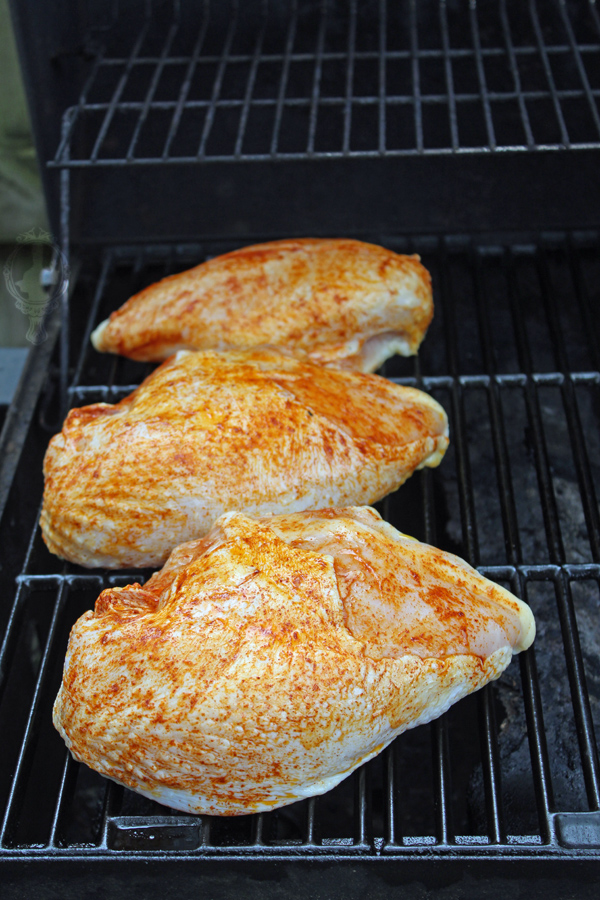 Raw chicken placed on the grill to begin grilling.