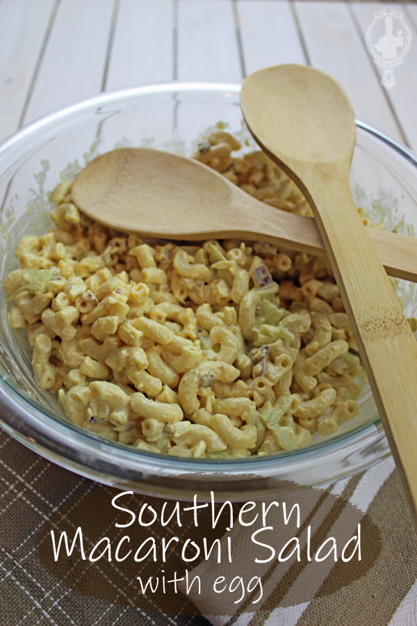 Southern Macaroni Salad in a serving bowl with two wooden spoons resting on top.