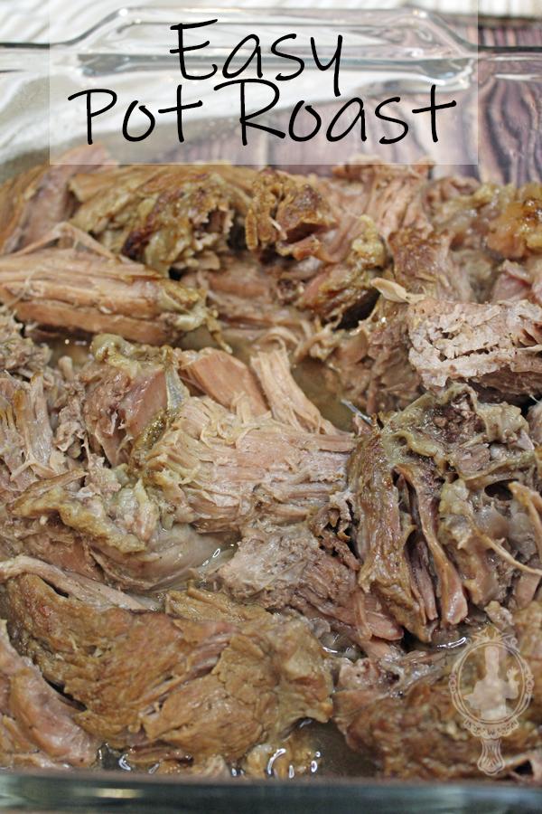 A baking dish with pot roast shredded.