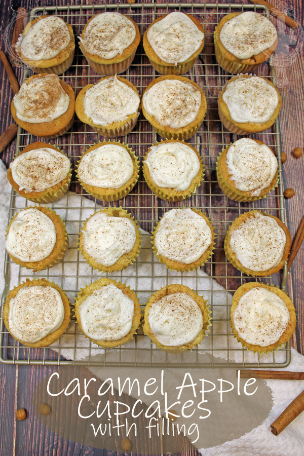 A cooling rack with caramel apple cupcakes lined up.