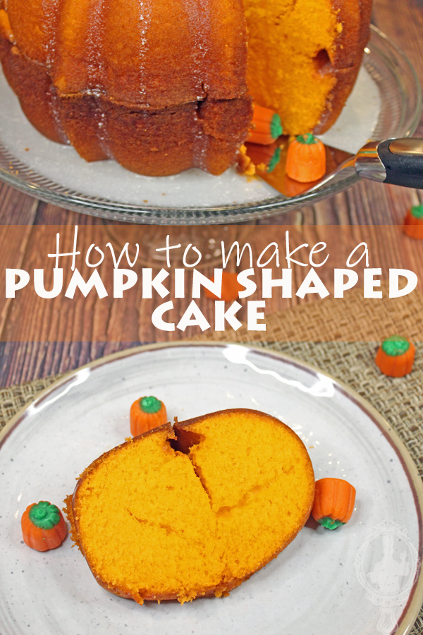 A slice of pumpkin shaped cake on a serving plate with candy pumpkins on and off the plate.