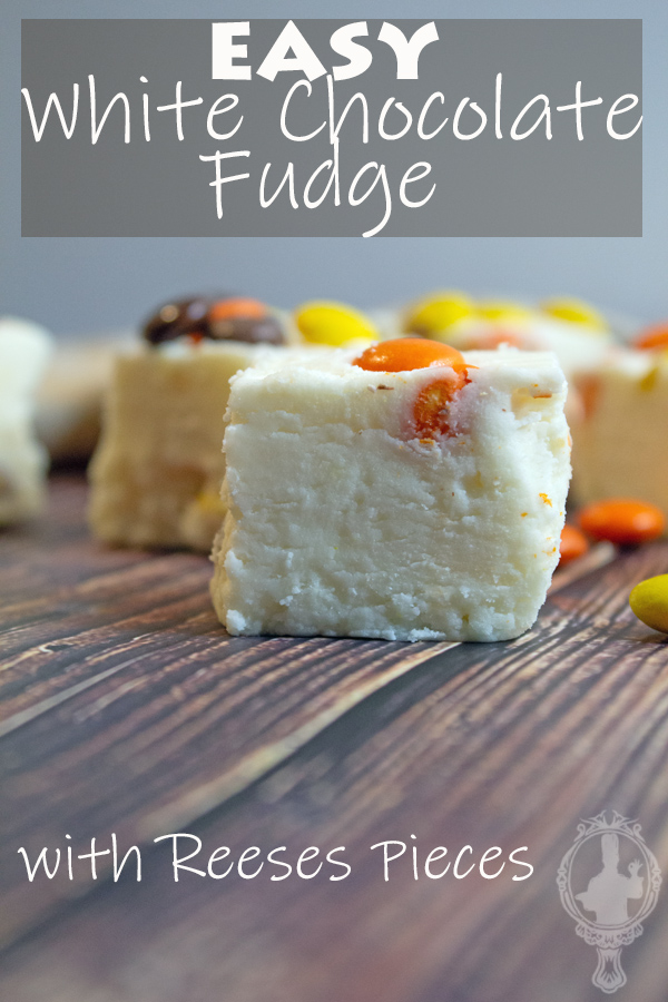 Straight on view of a chunk of Reeses Pieces White Chocolate Fudge