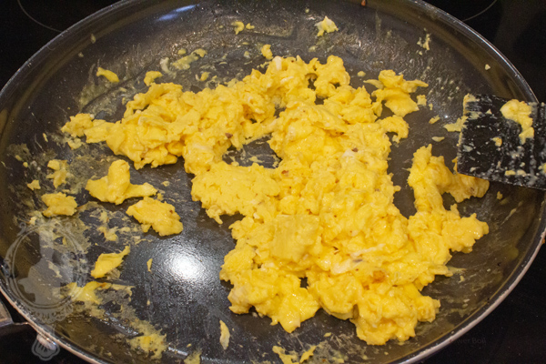 Frying pan with scrambled eggs.