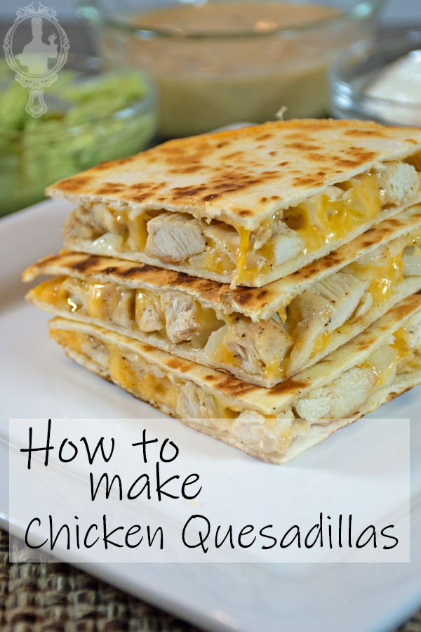 3 wedges of a chicken quesadilla stack on each other.