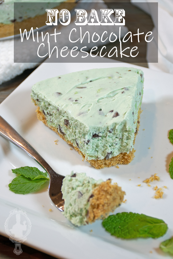 A slice of mint chocolate cheesecake on a plate with a bite on a fork just waiting to be eaten.