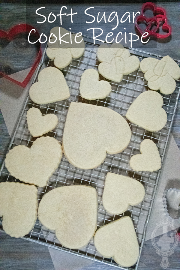 Overhead view of soft sugar cookies on a cooling rack.