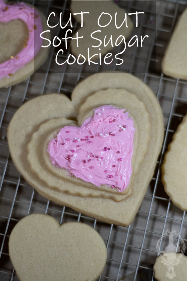 Overhead view of 3 heart cookies stacked on each other. The top one is frosted.