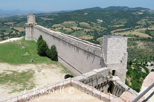 Octagonal look-out tower and connecting wall, Rocca Maggiore, Assisi, Italy.