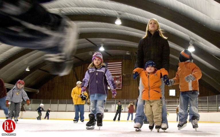 WATERTOWN, CT. 19 February 2007--021907SV02--Sharon Defeo of Watertown enjoys skating with her children, Peyton, 2, Cameron, 7, and Chloe, 5, during the Watertown Park and Recreation Department indoor skate at the Taft School