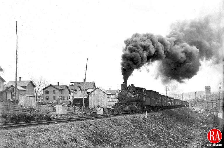 The New York & New England train passes through Brooklyn neighborhood in Waterbury on 05 April 1894.