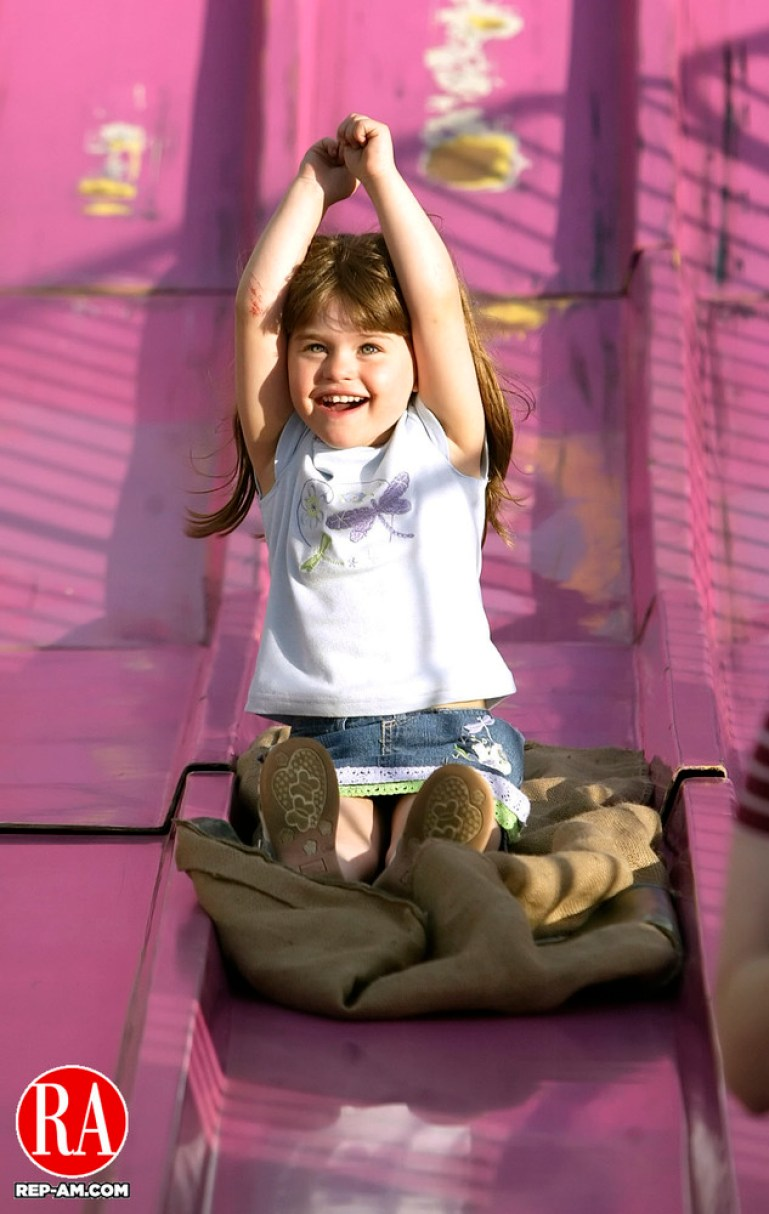 WATERTOWN, CT, 5 May 2006- 050506BZ11- Hailey Kalka (CQ), 4, of Watertown, rides the giant slide at the St. Mary Magdalen Parish School Carnival in Oakville Friday night. Jamison C. Bazinet Republican-American