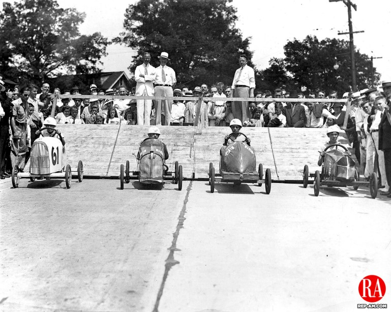 Participants are off for the start of the first annual Soap Box Derby, sponsored by the Republican-American on July 19, 1936. Pictured from left to right are: Roland Hamel, Russell Schmitt, Albert Forgue, and Gustave Luschenat.The race started at East Main Street, and went from Cavalry Cemetery to Mattatuck Mfg. Co.