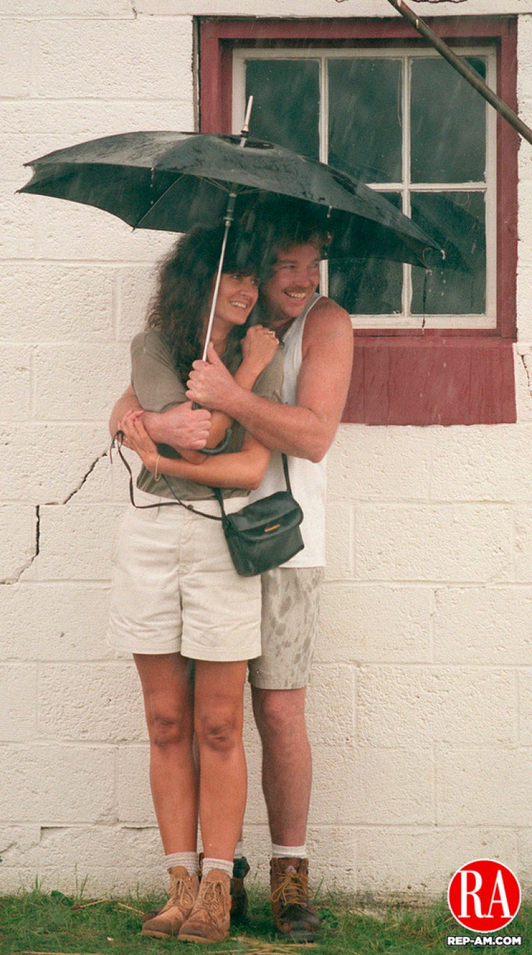 GOSHEN, CT 09/07/98 --0907JH01.tif--Lynn and Dennis Mulhern of Waterbury huddle under an umbrella as a sudden shower drenched the Goshen fairgrounds Monday afternoon. JOHN HARVEY staff photo for Smith story.