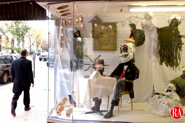 October 25, 2006 - WATERBURY - A pedestrian walk past the decorated windows of John Bale Book Company on Grand Street in Waterbury on Wednesday. Many stores in the downtown area are gearing up for the annual Mardi Gross halloween celebration. -Jim Shannon Republican-American