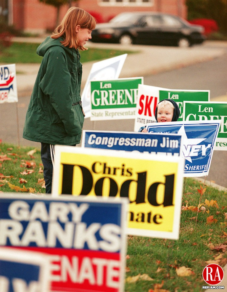 BEACON FALLS - 11/03/98 - Rebecca Rydzik,10, and Jeffrey Moffat,2, both of Beacon Falls get lost in a sea of signs outside Laurel Ledge school in Beacon Falls while their parents vote on Tuesday. Photo by Steven Valenti Republican-American