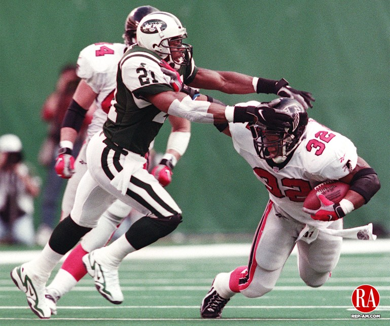 October 25, 1998 - EAST RUTHERFORD, NJ - The Falcons Jamal Anderson (32) is pulled down in the second half by the Jets Victor Green (21) Sunday at The Meadowlands. Photo by Bob Falcetti Republican-American
