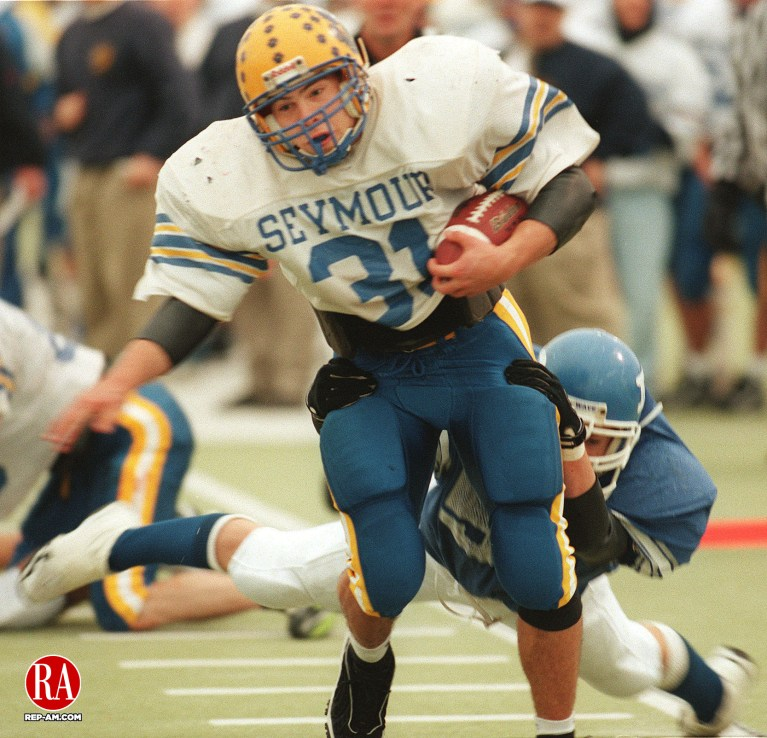 December 5, 1998 - WEST HAVEN,CT - #31 Matt Syombathy of Seymour drives for yardage as #5 Brian Chacos of Darien trys to pull him down during the CIAC Class M State Football Championship in West Haven on Saturday. Seymour Won. Photo by Steven Valenti Republican-American