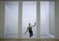 Man in a sealed glass room