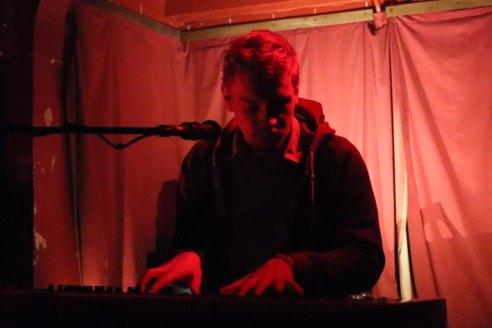 Photo of pianist Torsten Jensen with Red background