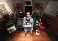 Audio Engineer Marc Urselli standing within a recording studio