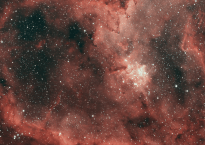 Image of a starry sky with a red-orange tint