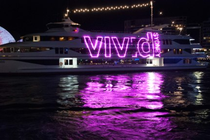 Brilliant colours of the Vivid Festival in Sydney, 2014, reflected everywhere including the water.