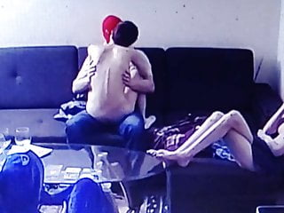 Younger couple having intercourse and younger couple watching