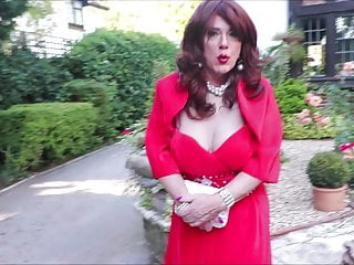 SIndy in crimson cocktail gown and jacket outdoors