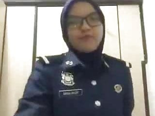 muslim police lady feeling her hijab out and display her booty