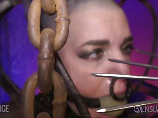 Shaved slave in cage with large ball gag