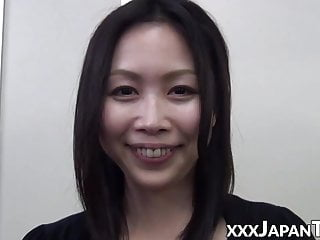 Handsome Oriental vixen stuffs mouth with plastic dick