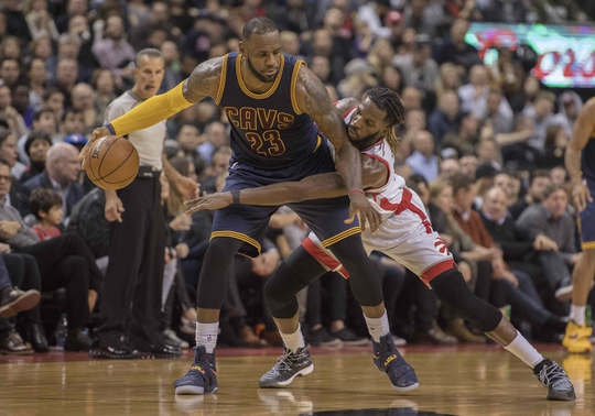 Oct 28, 2016; Toronto, Ontario, CAN; Cleveland Cavaliers forward LeBron James (23) dribbles the ball as Toronto Raptors forward DeMarre Carroll (5) defends during the third quarter at Air Canada Centre. The Cavaliers won 94-91. Mandatory Credit: Nick Turchiaro-USA TODAY Sports
