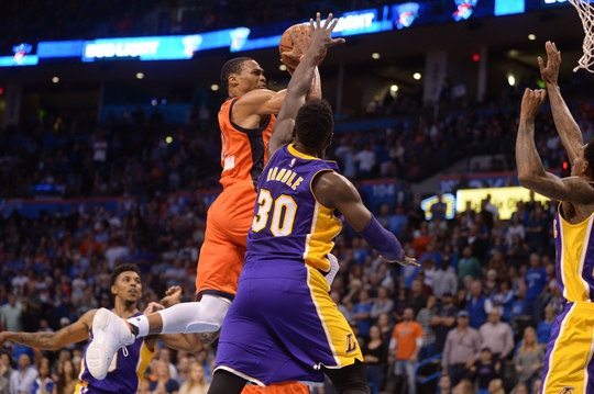 Oct 30, 2016; Oklahoma City, OK, USA; Oklahoma City Thunder guard Russell Westbrook (0) drives to the basket against Los Angeles Lakers forward Julius Randle (30) during the fourth quarter at Chesapeake Energy Arena. Mandatory Credit: Mark D. Smith-USA TODAY Sports