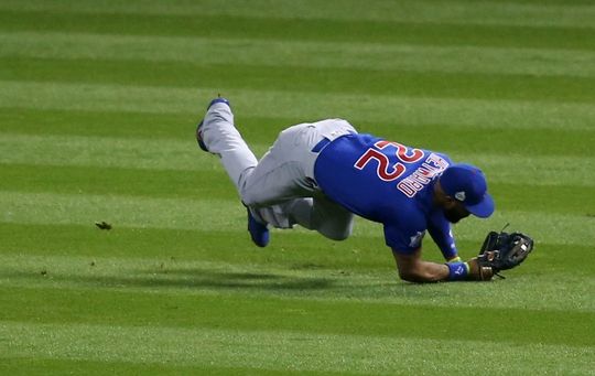 Nov 1, 2016; Cleveland, OH, USA; Chicago Cubs right fielder Jason Heyward (22) makes a diving catch on a ball hit by Cleveland Indians third baseman Jose Ramirez (not pictured) in the fourth inning in game six of the 2016 World Series at Progressive Field. Mandatory Credit: Charles LeClaire-USA TODAY Sports