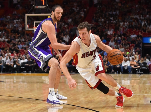 Nov 1, 2016; Miami, FL, USA; Miami Heat guard Goran Dragic (7) dribbles the ball around Sacramento Kings center Kosta Koufos (41) during the second half at American Airlines Arena. The Miami Heat defeat the Sacramento Kings 108-96 in overtime. Mandatory Credit: Jasen Vinlove-USA TODAY Sports