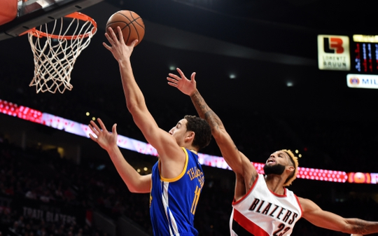 Nov 1, 2016; Portland, OR, USA; Golden State Warriors guard Klay Thompson (11) drives to the basket on Portland Trail Blazers guard Allen Crabbe (23) during the first quarter of the game at the Moda Center at the Rose Quarter. Mandatory Credit: Steve Dykes-USA TODAY Sports