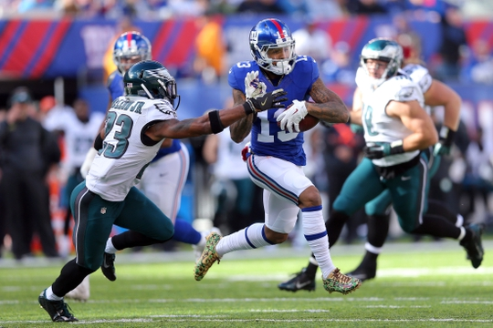 Nov 6, 2016; East Rutherford, NJ, USA; New York Giants wide receiver Odell Beckham Jr. (13) runs by Philadelphia Eagles safety Rodney McLeod (23) for a touchdown during the first quarter at MetLife Stadium. Mandatory Credit: Brad Penner-USA TODAY Sports